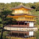 The Kinkaku-ji, or Golden Pavilion, in Kyoto, Japan. The top two stories of this Buddhist temple are painted in pure gold leaf.