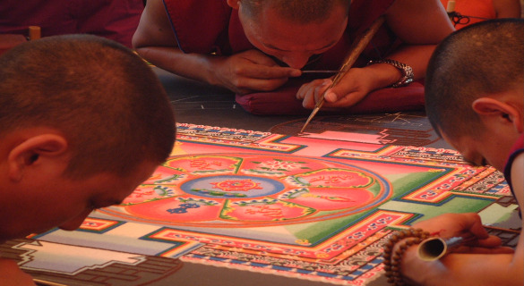 Tibetan monks creating a mandala